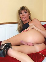 Sweet transsexual teasing with her cock and ass