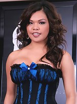 Beautiful busty TS posing in sexy corset