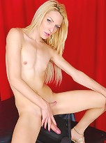 Blonde tgirl strips and poses