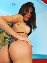 Hot brunette stripping for the camera