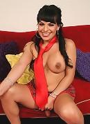 TS Foxxy posing in naughty schoolgirl costume