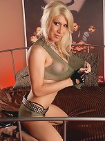 Irresistible transsexual posing on bed