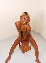 Blonde ladyboy strips down to panties