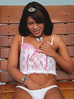 Shemale strips out of pink lingerie