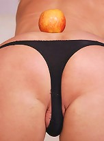 Lusty blonde T-girl cums on apple