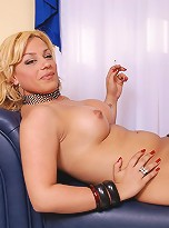 Blonde shemale strips and teases the camera