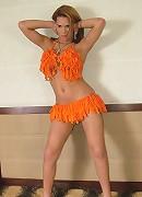 Shemale slut struts her stuff in her orange ruffles