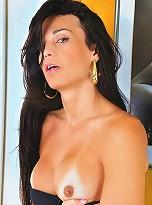 Amanda Bergman strips and strokes her cock